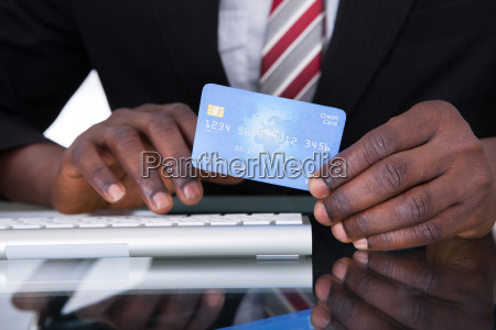 businessperson holding credit card