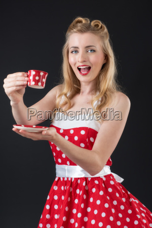 woman in summer dress drinking coffee