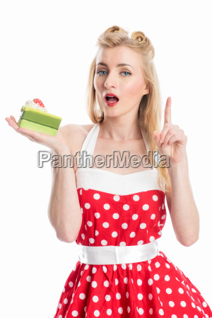 a blonde woman holds a piece