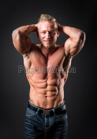 bodybuilder makes muscle training