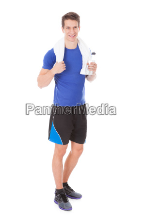 athlete holding water bottle in hand