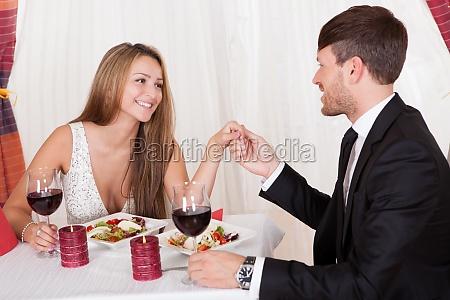 loving couple enjoying a romantic meal