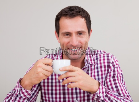 portrait of young man drinking having