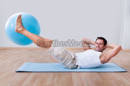 young man exercising on a pilates