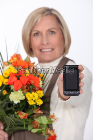 mature woman showing mobile phone