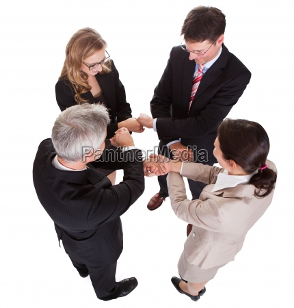 businesspeople holding hands teamwork