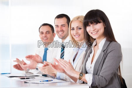 happy business people clapping