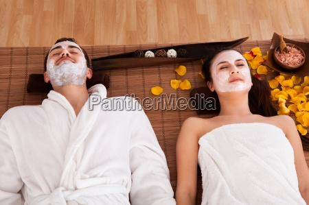 couple with face mask in spa