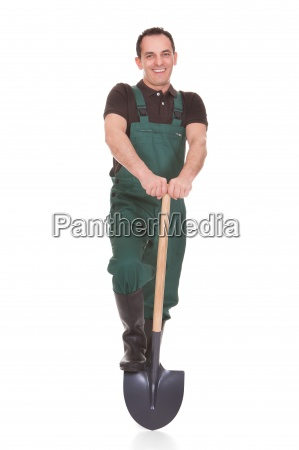 portrait of a male worker holding