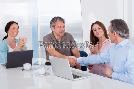 two businessman shaking hand
