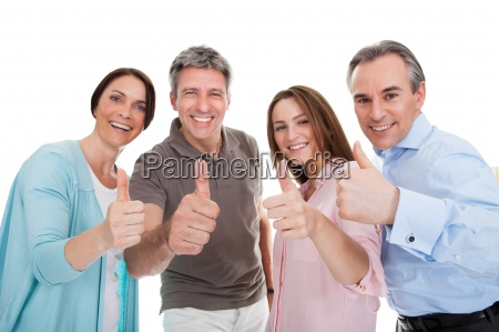 group of happy people showing thumb
