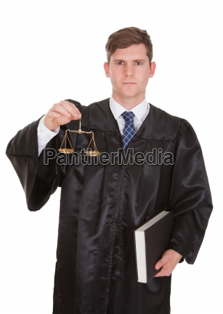 male lawyer with weight scale and