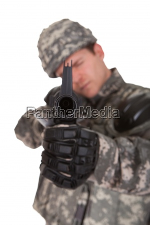 close up of solider aiming at