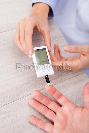 doctor checking sugar level