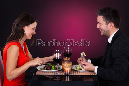 young couple having dinner with wine