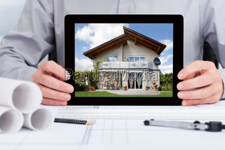 architect showing picture of house