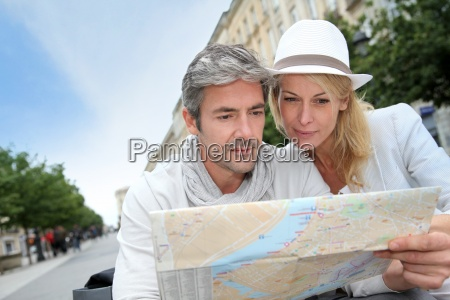 middle aged couple looking at city