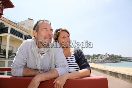 senior couple in seaside resort looking