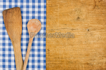 wood background with checked tablecloth and