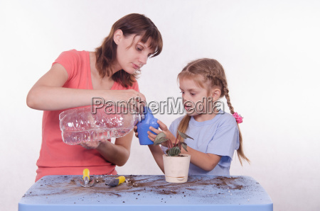 mom and daughter poured water into