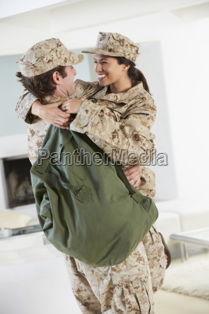 military couple greeting each other on