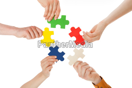 friends holding colorful jigsaw pieces