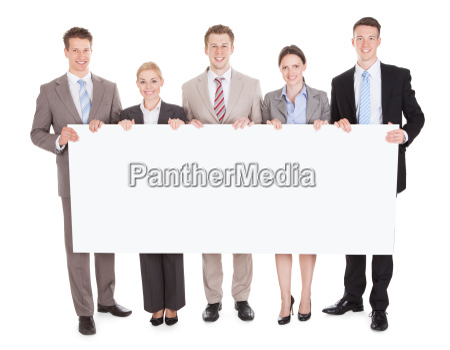 business people looking at blank billboard
