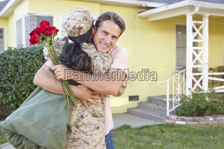 husband welcoming wife home on army
