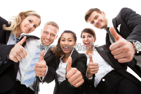 portrait of business people gesturing thumbs