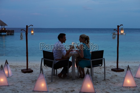 couple enjoying late meal in outdoor