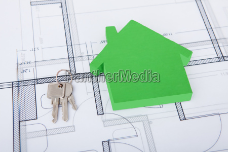 green house and keys on blueprint