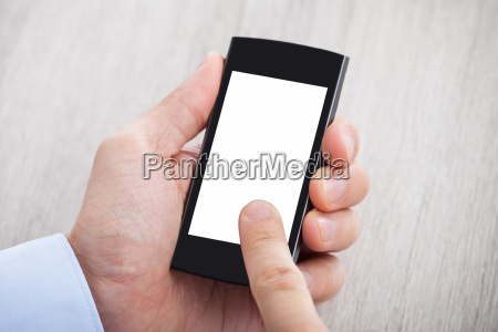 businessmans hand holding smartphone with blank