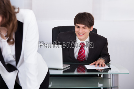 businessman staring at womans back