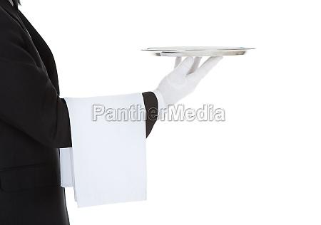 cropped image of waiter holding empty