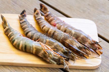 fresh prawns on a wooden board