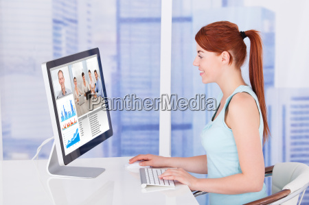 businesswoman video conferencing with team on