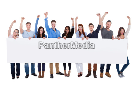 excited group of diverse people holding