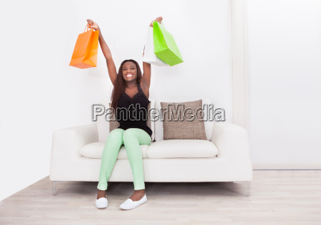 woman carrying shopping bags in living