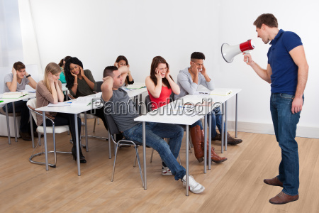 teacher shouting through megaphone on university