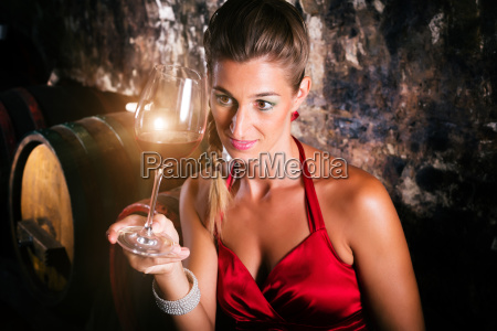 woman in wine cellar with wine