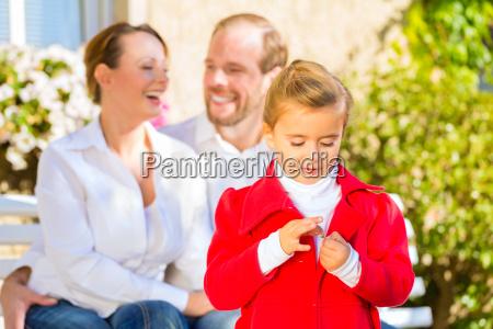 family on garden bench