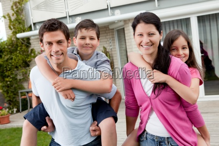 playful young family enjoying together
