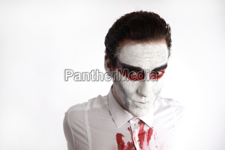 man with white mascara and bloody