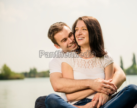 young happy couple in nature