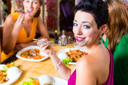 young people eat in asia restaurant
