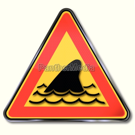 sign with shark fin and underwater