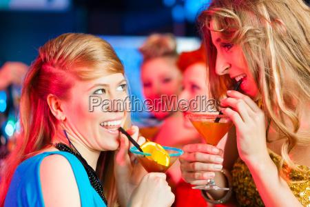 women in a club or disco