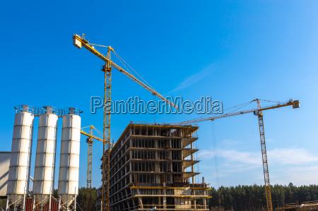 building cranes on construction