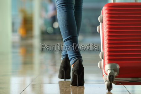 traveler woman legs walking carrying a