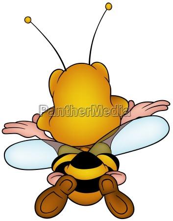 flying honeybee from the back